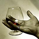Hand with the glass of brandy