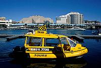 Darling harbour. Transport. Water Taxi. Bright yellow boat. Small size. Propellor driven