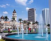 The Dataran Merdeka or Merdeka Square is at the heart of the city and the Sultan Abdul Samad Building with the tower and mosque domes dominated the Pa...