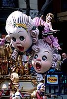 Fallas. Annual street festival. 13 to 19 March. Papier mache figures on floats. Giant heads. Ninots.