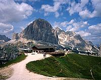 Tofana is a peak located in the Dolomites. It is 10,647 feet high. There is a mountainrefuge at the base.