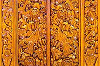 Intricate wood carving on Bali door