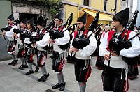 Parade of pipe bands through the streets of Llanes during the festival of San Roque, Llanes, Asturias, Spain
