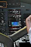 Garmin navigation control panel of the Air Seychelles DHC_6 twin otter,twin propeller plane during flight showing the satellite navigation system