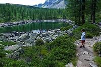 children next to the mountain lake, alpe devero, piedmont, italy
