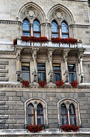 Flower boxes with red geraniums on the facade of City Hall, Vienna, Austria, Europe