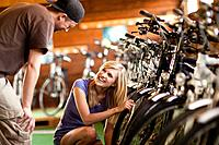 Young couple shopping for bicycles in bike shop