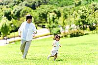Father and Daughter Running in Park