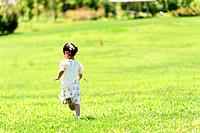 Girl Running on Grass