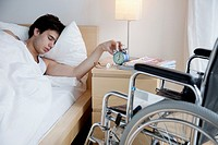 Man in bed and wheelchair