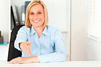 Businesswoman giving hand in her office