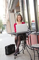 Russian businesswoman working at laptop computer in downtown Spokane, Washington, USA