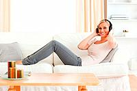 Woman enjoying some music in her living room