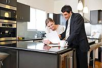 Businessman talking with woman in home