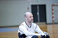 Man in wheelchair playing indoor sports