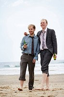 Businessmen walking on beach