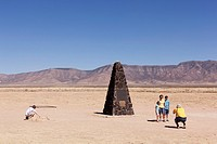 Sightseers at Trinity Site, a remote area of New Mexico where the world´s first nuclear device was exploded in 1945  An obelisk maks the site