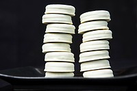 Stacks of cookies on plate