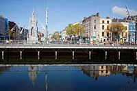 a bridge and buildings at the mall reflected into river lee, cork city county cork ireland