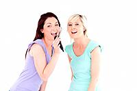 Women singing karaoke in a studio