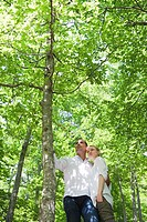 Couple in woods, low angle view