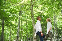Couple standing in woods