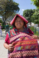 Mayan woman selling handmade textiles and souvenirs, Antigua, Guatemala