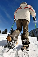 Woman walking with snowshoes, La Molina ski resort, Girona, Catalonia. Spain