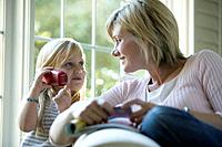 Mother and Daughter Using Cordless Phone
