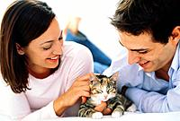 Young Couple with Pet Kitten