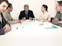 Five Businesspeople in Meeting