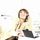Businesswoman Sitting at Desk Phoning