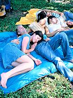Group of young people lying on a meadow