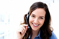 Germany, Bavaria, Diessen am Ammersee, Young businesswoman using headset, smiling, portrait