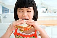 A girl eating a sandwich