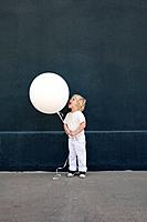 Little boy yelling at a balloon