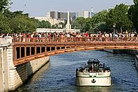 People on a bridge above the river Seine, Paris, France, Europe