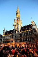Hotel de Ville, people in front of townhall in the evening, Grand Place, Brussels, Belgium, Europe
