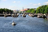 Boat in front of the Amstel lock, Amstelsluizen in the Amstel river, Amsterdam, the Netherlands, Europe