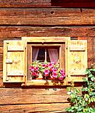 Flower decorated window of an old timber building