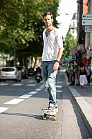 Man skateboarding on the road, Paris, Ile_de_France, France