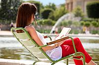 Woman reading a magazine, Jardin des Tuileries, Paris, Ile_de_France, France