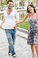 Couple enjoying near a canal, Paris, Ile_de_France, France
