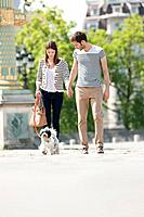 Couple walking with a puppy, Paris, Ile_de_France, France