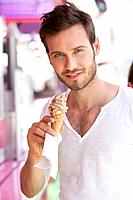 Portrait of a man eating ice cream, Paris, Ile_de_France, France