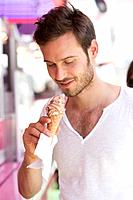 Close_up of a man eating ice cream, Paris, Ile_de_France, France