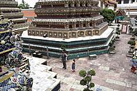 Father and daughter 10 years visiting Wat Pho Temple, Bangkok, Thailand