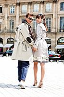 Couple walking on a street, Paris, Ile_de_France, France