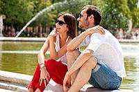 Couple sitting in a garden, Bassin octogonal, Jardin des Tuileries, Paris, Ile_de_France, France