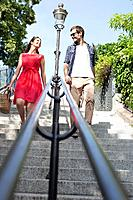 Couple moving down staircases, Montmartre, Paris, Ile_de_France, France